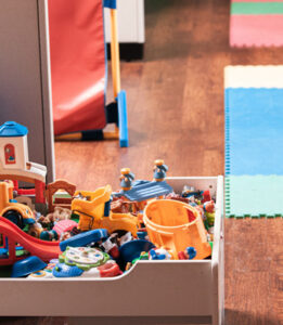 image of a messy toy box in kids room waiting to be decluttered
